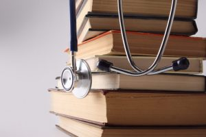 Stethoscope on pile of books